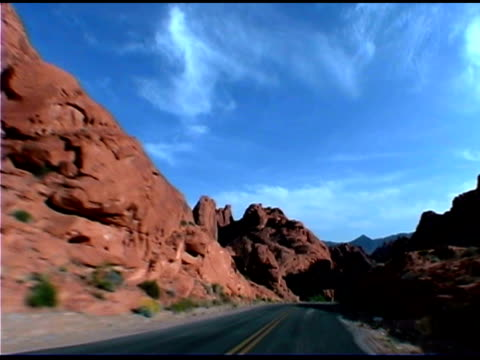 pov of driving on mountain road, valley of fire state park, nevada - state park stock videos & royalty-free footage