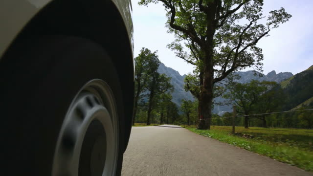 pov driving on mountain road - straßenrand stock videos and b-roll footage