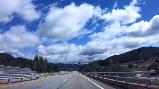 driving on national road / pyeongchang-gun, gangwon-do, south korea - cumulus stock videos & royalty-free footage