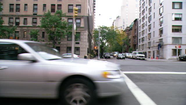DS Driving on Park Avenue with traffic and residential and office buildings beyond / New York City, New York, United States