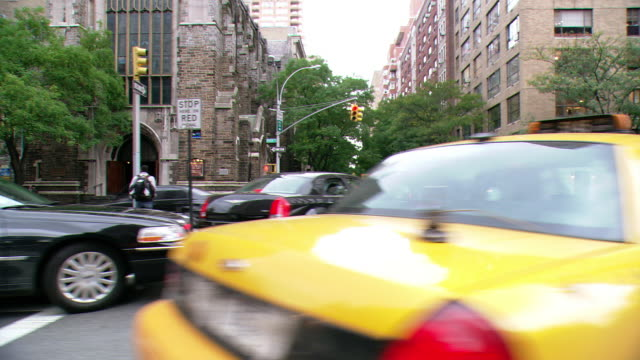 ds driving on park avenue, with traffic, pedestrians, and residential and buildings beyond / new york city, new york, united states - median nerve stock videos & royalty-free footage