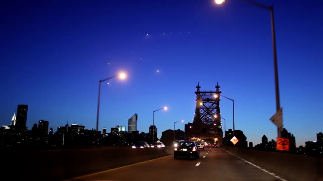 POV Driving on Queensboro Bridge from Queens to Manhattan at dusk, New York City, New York, USA