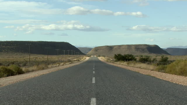 rear pov driving on road in desert landscape / karoo, south africa - the karoo stock videos & royalty-free footage