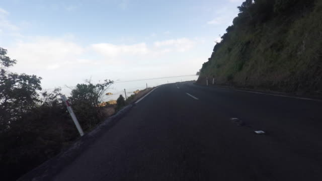 pov, driving on road to the seaside - car point of view stock videos & royalty-free footage