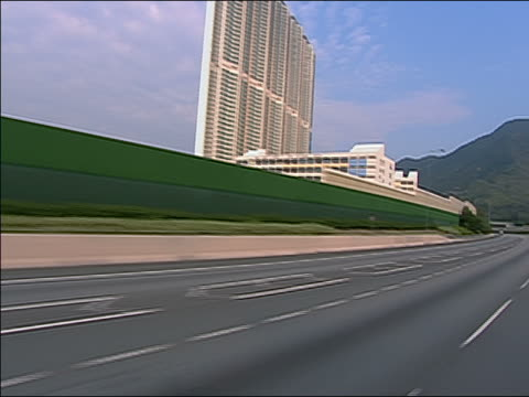 various ws ms ts driving on roads and highways in hong kong. buildings visible in b/g at times, other vehicles visible throughout. - other stock videos & royalty-free footage