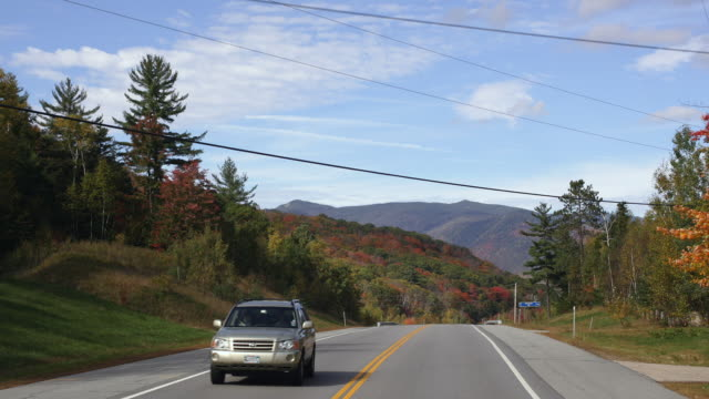T/L POV Driving on route 302 towards Crawford Notch, Autumn / New Hampshire, USA