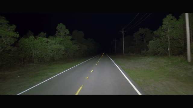 POV Driving on rural highway at night