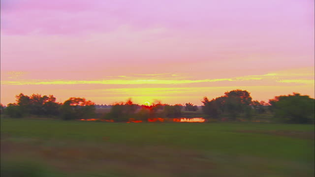 side pov, driving on rural road at sunrise, near tulsa, oklahoma, usa - oklahoma stock-videos und b-roll-filmmaterial
