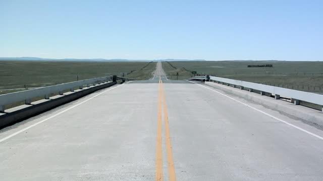 pov driving on rural road in south dakota, usa - south dakota stock-videos und b-roll-filmmaterial
