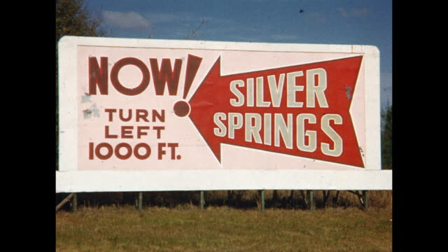 vidéos et rushes de 1954 montage pov driving on rural road, sign for silver springs, florida, usa - message
