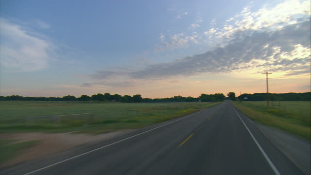 POV Driving on rural two-lane highway at sunrise, Fredericksburg, Texas, USA