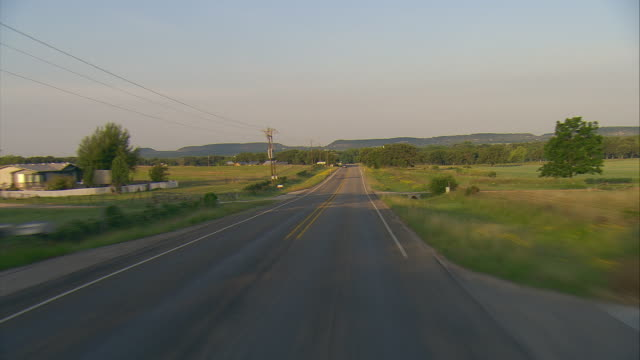 POV Driving on rural two-lane highway in morning light, Fredericksburg, Texas, USA