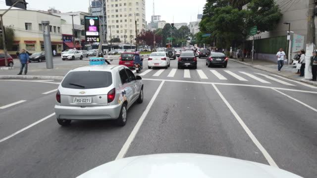 driving on sao paulo dowtown. traffic jam. doutor arnaldo ave. - doutor stock videos & royalty-free footage