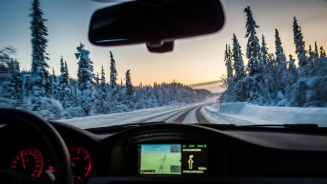 pov driving on snowy road in swedish lappland - snow stock videos & royalty-free footage