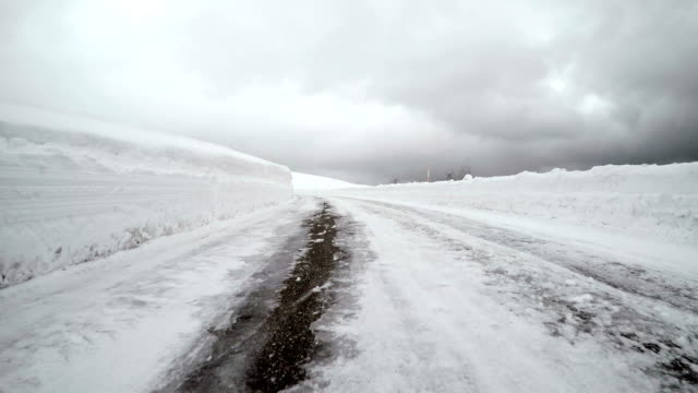 driving on snowy winter road - plusphoto stock videos & royalty-free footage