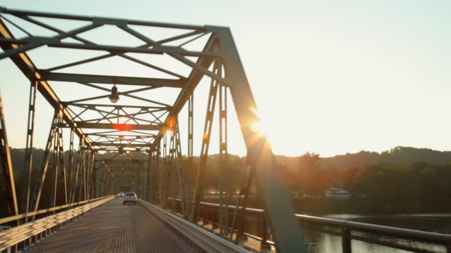 pov driving on steel bridge over delaware river at sunset / frenchtown, new jersey, usa - cultura americana video stock e b–roll
