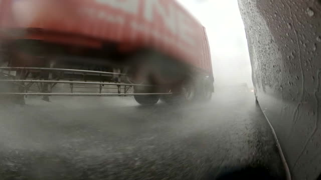 driving on stormy highway / cargo container - behind stock videos & royalty-free footage