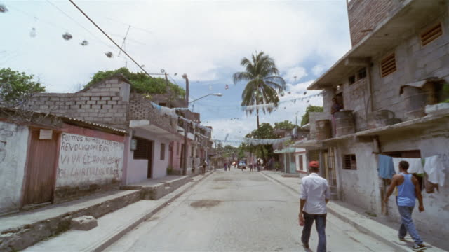pov, driving on street in residential area, santiago de cuba, cuba  - santiago de cuba stock videos and b-roll footage