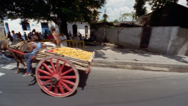 SIDE, REAR POV driving on street, passing horse drawn cart, Santiago de Cuba, Cuba