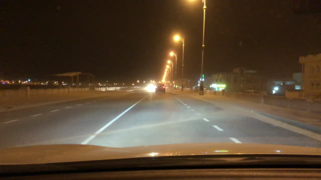 pov driving on suburban road in oman at night - remote location stock videos & royalty-free footage