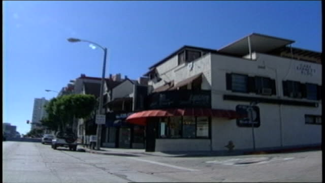 driving pov on sunset blvd in los angeles california - sunset boulevard stock-videos und b-roll-filmmaterial