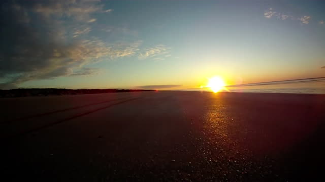 hd: driving on the beach at sunset - quadbike stock videos & royalty-free footage