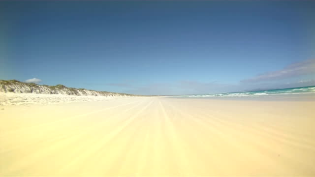 hd time lapse: driving on the beach - vignette stock videos & royalty-free footage
