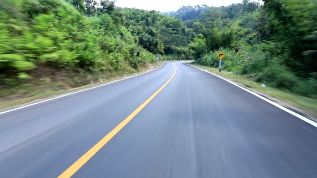 hd: driving on the empty winding road - empty road stock videos and b-roll footage
