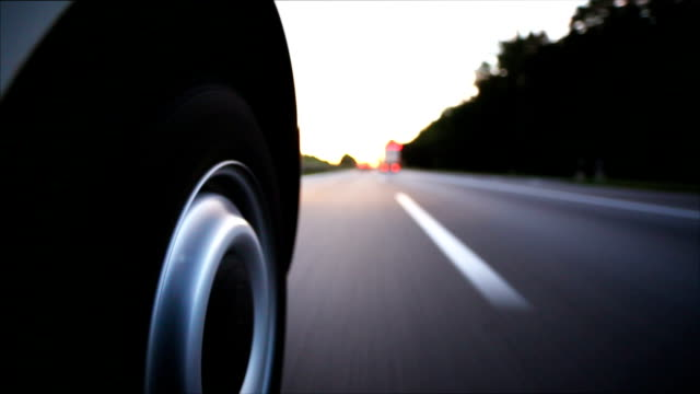 pov driving on the highway at sunset - tyre stock videos & royalty-free footage