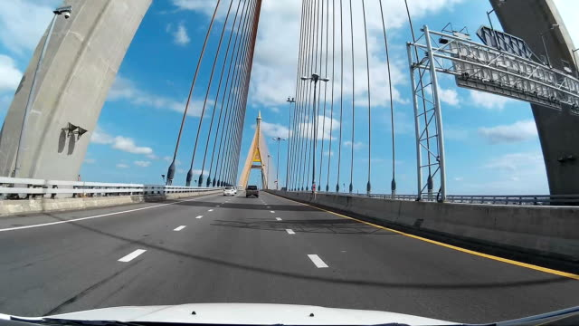 driving on the highway cable bridge - bridge built structure stock videos and b-roll footage