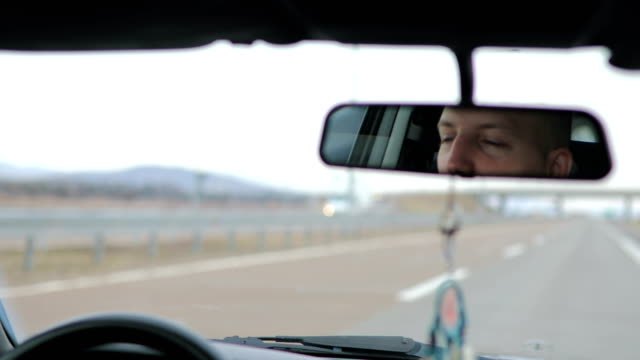 driving on the highway - rear view mirror stock videos & royalty-free footage