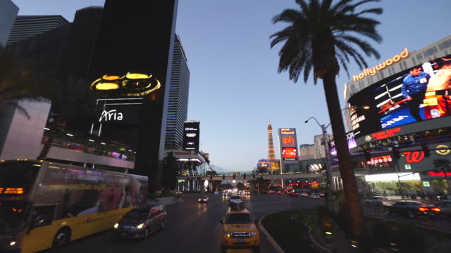 Driving POV on the Las Vegas strip at twilight, including Paris, Planet Hollywood and Aria properties