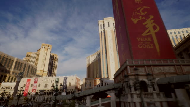 driving pov on the las vegas strip featuring venetian and palazzo hotels, daytime - the palazzo las vegas stock videos & royalty-free footage