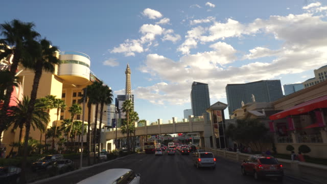 driving pov on the las vegas strip, late afternoon, featuring ballys and the eiffel tower at paris hotel - bally's las vegas stock videos & royalty-free footage