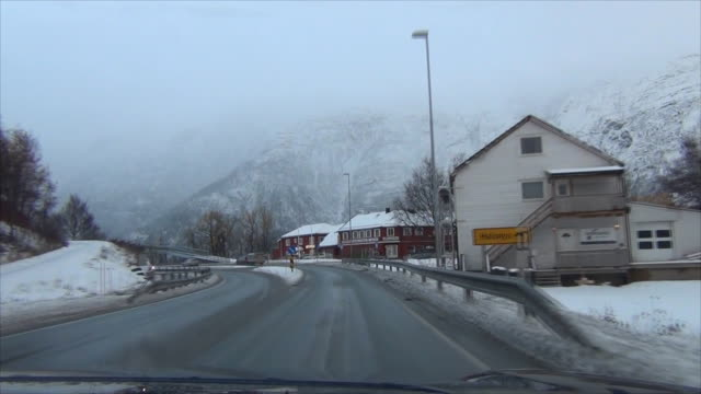 Driving on the Road in snowing , Norway.