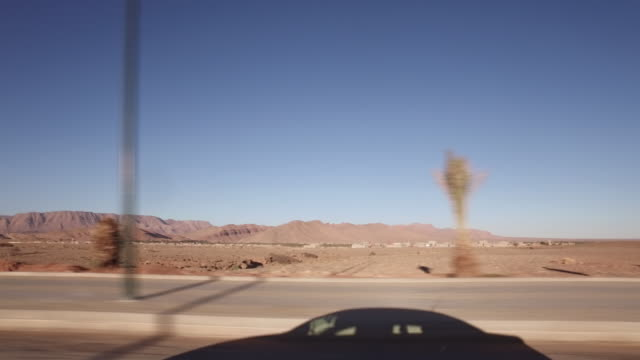 Driving on the way to deep Morocco desert
