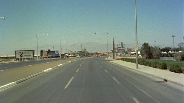 stockvideo's en b-roll-footage met pov driving on three lane highway through city outskirts / las vegas, nevada, usa - westers schrift