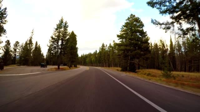 driving on wyoming the grand teton national park - grand teton stock videos & royalty-free footage