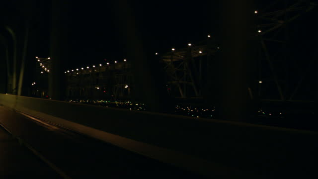 front pov driving over a bridge at night / new orleans, louisiana, united states - louisiana stock videos & royalty-free footage