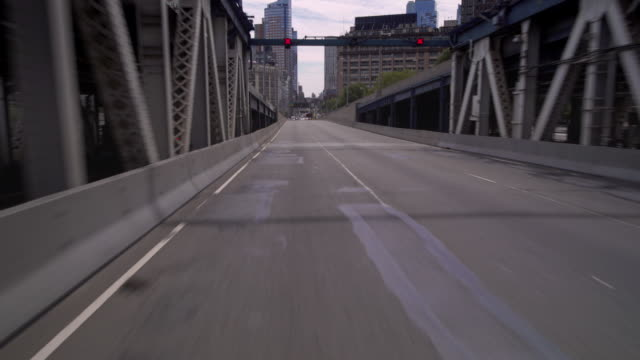 Driving over an empty Manhattan Bridge.
