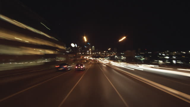 WS POV T/L Driving over Anzac bridge into Cross City Tunnel at night / Sydney, New South Wales, Australia