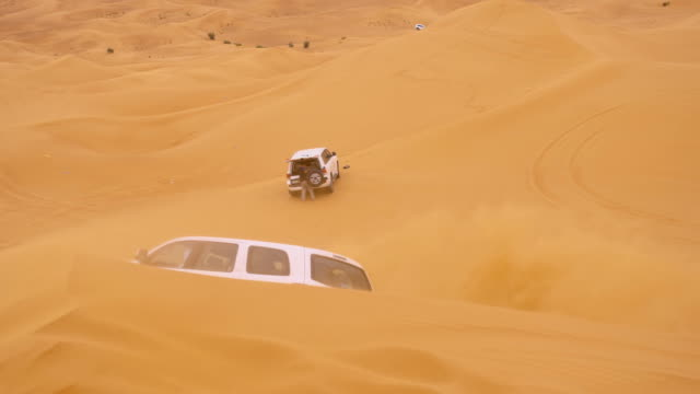 slo mo driving over sand dunes - 4x4 stock videos & royalty-free footage
