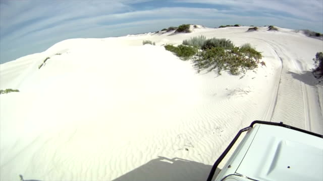 hd: driving over sand dunes - 4x4 stock videos & royalty-free footage