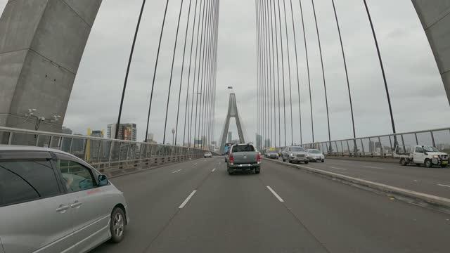 driving over the anzac bridge, sydney - war stock-videos und b-roll-filmmaterial