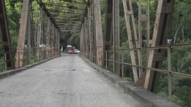 driving over the famous iron bridge in southern brazil. - metal blend stock videos and b-roll footage