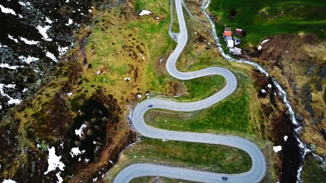 driving over the julier pass - winding road stock-videos und b-roll-filmmaterial