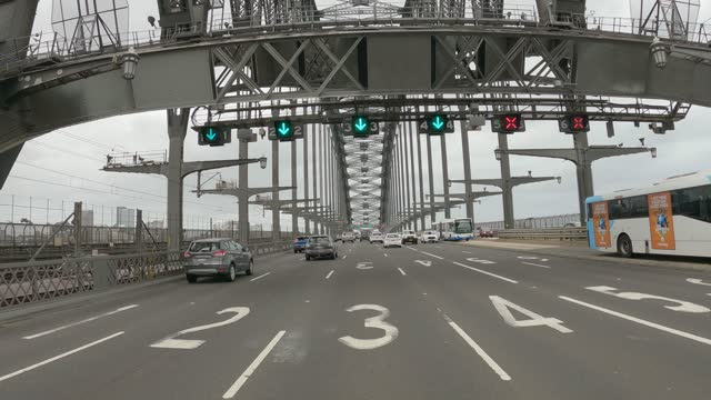 driving over the sydney harbour bridge in traffic, car point of view - road sign stock videos & royalty-free footage