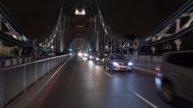 Driving over Tower Bridge, London At night.