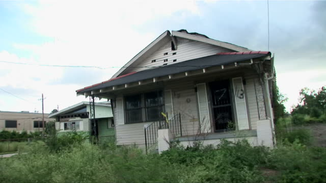 passenger pov driving past abandoned houses in the ninth ward/ new orleans, louisiana - hurricane katrina stock videos and b-roll footage