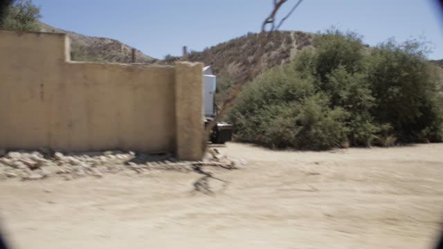 pov driving past adobe buildings in santa clarita / california, united states - santa clarita点の映像素材/bロール